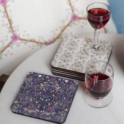 Floral and botanical design coasters available in cream and navy inspired by Escape to the Chateau's wildflower gardens