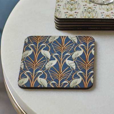 Teal blue coasters featuring heron and grass design