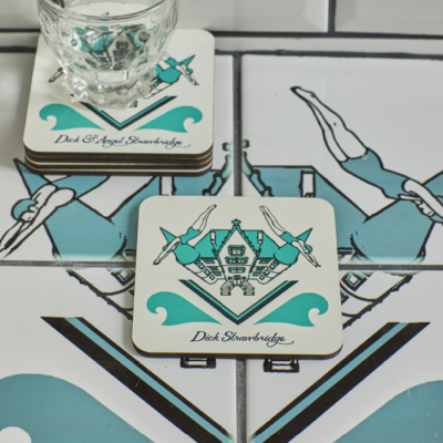 Turquoise and white coasters featuring retro symmetrical diving woman pattern