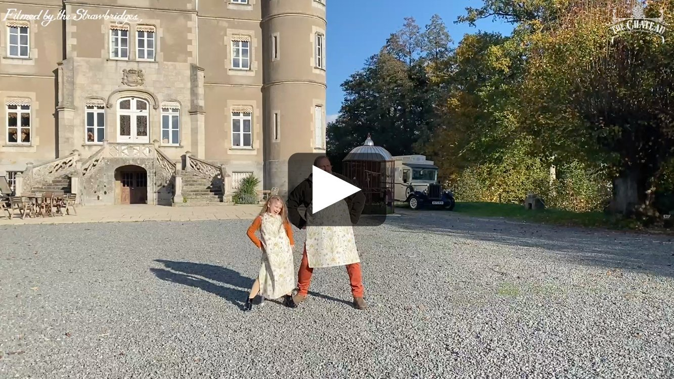 Video frame of Dick and Dorothy trying on their new aprons, link to full video