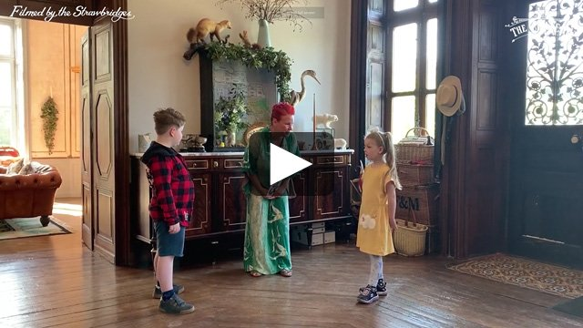 Video frame of Angel, Arthur and Dorothy in the hallway, link to full video