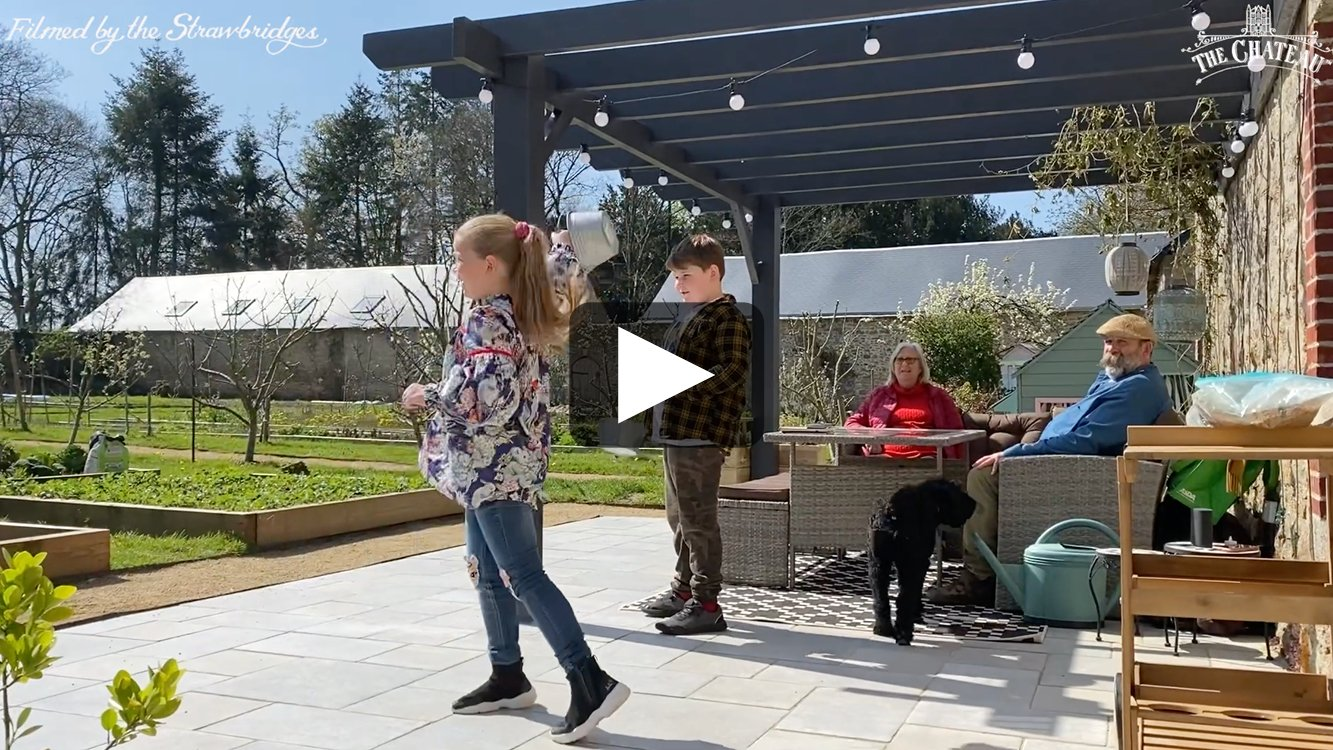 Video frame of Arthur and Dorothy getting ready to hunt for eggs in the walled garden