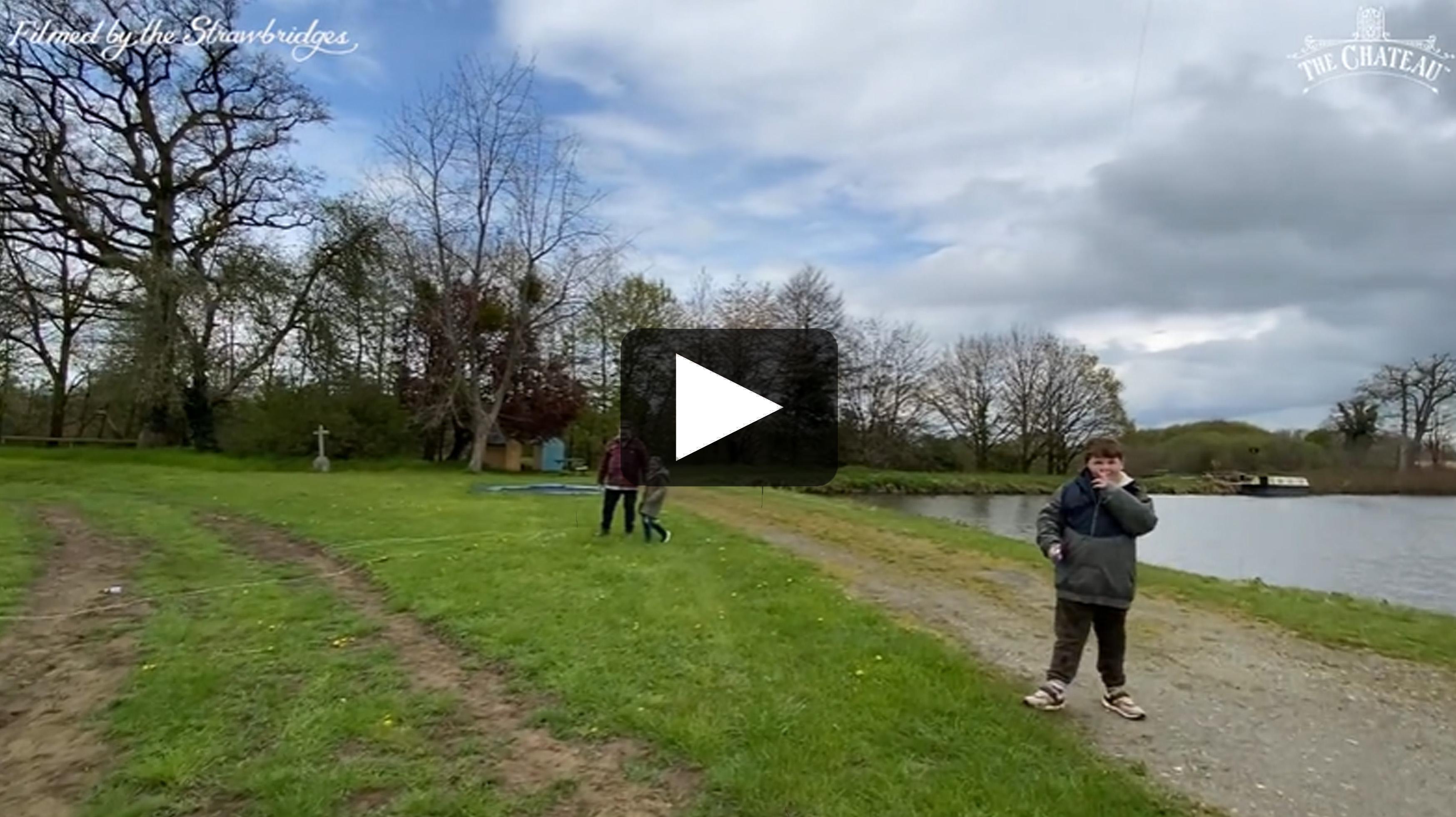 Video frame of the Strawbridges flying a kite.
